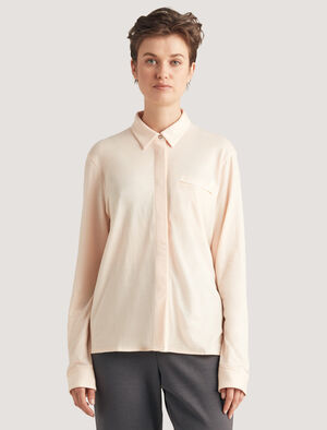 Womens Merino Shirt A go-anywhere shirt in naturally odor-resistant and breathable merino wool, the Merino Shirt has a flattering drop-tail hem, a chest pocket and a zippered pocket at the side.