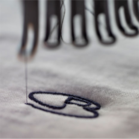 icebreaker's logo being embroidered
